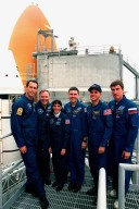 """KENNEDY SPACE CENTER, Fla. -- STS-88 crew members pose for a photograph during a break in emergency egress training on launch pad 39A. They are (left to right) Mission Specialists James H. Newman , Jerry L. Ross and Nancy J. Currie, Mission Commander Robert D. Cabana, Pilot Frederick W. """"Rick"""" Sturckow and Mission Specialist Sergei Krikalev, a Russian cosmonaut. The crew are at KSC to participate in the Terminal Countdown Demonstration Test (TCDT), a dress rehearsal for launch. Mission STS-88 is targeted for launch on Dec. 3, 1998. It is the first U.S. flight for the assembly of the International Space Station and will carry the Unity connecting module"""