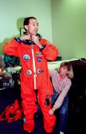 STS-88 Mission Specialist James H. Newman (left) suits up in the Operations and Checkout Building, as part of flight crew equipment fit check, prior to his trip to Launch Pad 39A. He is helped by suit tech Terri McKinney. The crew are at KSC to participate in the Terminal Countdown Demonstration Test (TCDT) which includes mission familiarization activities, emergency egress training, and the simulated main engine cut-off exercise. This is Newman's third space flight. Mission STS-88 is targeted for launch on Dec. 3, 1998. It is the first U.S. flight for the assembly of the International Space Station and will carry the Unity connecting module