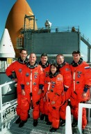 """KENNEDY SPACE CENTER, Fla. -- On Launch Pad 39A, the STS-88 crew pose after successfully completing a pre-launch countdown exercise as part of Terminal Countdown Demonstration Test. From left, they are Mission Specialist James H. Newman, Pilot Frederick W. """"Rick"""" Sturckow, Mission Commander Robert D. Cabana, and Mission Specialists Nancy J. Currie, Ph.D., Jerry L. Ross and Sergei Konstantinovich Krikalev, a Russian cosmonaut. Mission STS-88 is targeted for launch on Dec. 3, 1998. It is the first U.S. flight for the assembly of the International Space Station and will carry the Unity connecting module. Unity will be mated with the already orbiting Russian-built Zarya control module. The 12-day mission includes three planned spacewalks to connect power, data and utility lines and install exterior equipment"""
