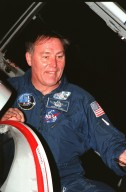 """A smiling STS-88 Mission Specialist Jerry L. Ross prepares to exit the T-38 jet aircraft that brought him to the Shuttle Landing Facility. He joins the five other crew members, Commander Robert D. Cabana, Pilot Frederick W. """"Rick"""" Sturckow, and Mission Specialists Nancy J. Currie, James H. Newman and Sergei Konstantinovich Krikalev, a Russian cosmonaut, for prelaunch preparations for mission STS-88 aboard Space Shuttle Endeavour. The scheduled time of launch is 3:56 a.m. EST on Dec. 3 from Launch Pad 39A. The mission is the first U.S. launch for the International Space Station. Endeavour carries the Unity connecting module which the crew will be mating with the Russian-built Zarya control module already in orbit. In addition to Unity, Endeavour will carry two small replacement electronics boxes for possible repairs to Zarya batteries. The mission is scheduled to last nearly 12 days"""