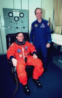 STS-88 Mission Specialist Jerry L. Ross (left) and astronaut Charles Precourt pose for a photo during suiting up activities in the Operations and Checkout Building. STS-88 will be the sixth spaceflight for Ross, who is scheduled to perform three spacewalks on the mission. He and the five other STS-88 crew members will depart shortly for Launch Pad 39A where the Space Shuttle Endeavour is poised for liftoff on the first U.S. mission dedicated to the assembly of the International Space Station
