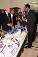 Ohio Senator John Glenn, at left, enjoys a tour of the SPACEHAB Payload Processing Facility in Cape Canaveral. Joining Senator Glenn are, left to right, Dale Steffey, SPACEHAB vice president, operations; Dr. Shelley Harrison, SPACEHAB chairman and chief executive officer; and Dr. Bernard Harris, SPACEHAB vice president, microgravity and life sciences. Senator Glenn arrived at KSC on Jan. 20 to tour KSC operational areas and to view the launch of STS-89 later this week. Glenn, who made history in 1962 as the first American to orbit the Earth, completing three orbits in a five-hour flight aboard Friendship 7, will fly his second space mission aboard Space Shuttle Discovery this October. Glenn is retiring from the Senate at the end of this year and will be a payload specialist aboard STS-95