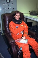 STS-89 Mission Specialist Bonnie Dunbar, Ph.D., smiles as she completes the donning of her launch/entry suit in the Operations and Checkout (O&C) Building. Dr. Dunbar completed her doctorate at the University of Houston in Texas. Her multi-disciplinary dissertation (materials science and physiology) involved evaluating the effects of simulated space flight on bone strength and fracture toughness. She and six fellow crew members will shortly depart the O&C and head for Launch Pad 39A, where the Space Shuttle Endeavour will lift off during a launch window that opens at 9:43 p.m. EST, Jan. 22. STS-89 is the eighth of nine planned missions to dock the Space Shuttle with Russia's Mir space station