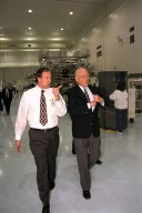 Ohio Senator John Glenn, at right, enjoys a tour of the Space Station Processing Facility at Kennedy Space Center. With Senator Glenn is Stephen Francois, director, Space Station and Shuttle Payloads, NASA. Senator Glenn arrived at KSC on Jan. 20 to tour KSC operational areas and to view the launch of STS-89. Glenn, who made history in 1962 as the first American to orbit the Earth, completing three orbits in a five-hour flight aboard Friendship 7, will fly his second space mission aboard Space Shuttle Discovery this October. Glenn is retiring from the Senate at the end of this year and will be a payload specialist aboard STS-95