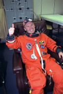 STS-89 Mission Specialist Andrew Thomas, Ph.D., gives a ?thumbs up? as he completes the donning of his launch/entry suit in the Operations and Checkout (O&C) Building. In June 1995, he was named as payload commander for STS-77 and flew his first flight in space on Endeavour in May 1996. He and six fellow crew members will soon depart the O&C and head for Launch Pad 39A, where the Space Shuttle Endeavour will lift off during a launch window that opens at 9:43 p.m. EST, Jan. 22. STS-89 is the eighth of nine planned missions to dock the Space Shuttle with Russia's Mir space station, where Dr. Thomas will succeed David Wolf, M.D