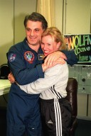 NASA astronaut and Mir 24 crew member David Wolf, M.D., who was on the Russian Space Station Mir since late September 1997, greets his friend, Tammy Kruse, shortly after his return to Earth on Jan. 31. Dr. Wolf returned aboard the orbiter Endeavour with the rest of the STS-89 crew, including Commander Terrence Wilcutt; Pilot Joe Edwards Jr.; and Mission Specialists James Reilly, Ph.D.; Michael Anderson; Bonnie Dunbar, Ph.D.; and Salizhan Sharipov with the Russian Space Agency. STS-89 Mission Specialist Andrew Thomas, Ph.D., succeeded Dr. Wolf on Mir and is scheduled to remain on the Russian space station until the STS-91 Shuttle mission returns in June 1998. In addition to the docking and crew exchange, STS-89 included the transfer of science, logistical equipment and supplies between the two orbiting spacecrafts