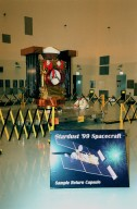 In the Payload Hazardous Servicing Facility, the spacecraft Stardust is on display for a media presentation. Stardust is targeted for launch on Feb. 6 aboard a Boeing Delta II rocket from Launch Pad 17-A, Cape Canaveral Air Station. The spacecraft is destined for a close encounter with the comet Wild 2 in January 2004. Using a silicon-based substance called aerogel, Stardust will capture comet particles flying off the nucleus of the comet. The spacecraft also will bring back samples of interstellar dust. These materials consist of ancient pre-solar interstellar grains and other remnants left over from the formation of the solar system. Scientists expect their analysis to provide important insights into the evolution of the sun and planets and possibly into the origin of life itself. The collected samples will return to Earth in a sample return capsule (the white-topped, blunt-nosed cone seen on the top of the spacecraft) to be jettisoned as Stardust swings by Earth in January 2006