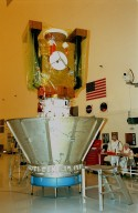 In the Payload Hazardous Servicing Facility, the Stardust spacecraft waits to be encased in a protective canister for its move to Launch Pad 17-A, Cape Canaveral Air Station, for launch preparations. Stardust is targeted for liftoff on Feb. 6 aboard a Boeing Delta II rocket for a close encounter with the comet Wild 2 in January 2004. Using a silicon-based substance called aerogel, Stardust will capture comet particles flying off the nucleus of the comet. The spacecraft also will bring back samples of interstellar dust. These materials consist of ancient pre-solar interstellar grains and other remnants left over from the formation of the solar system. Scientists expect their analysis to provide important insights into the evolution of the sun and planets and possibly into the origin of life itself. The collected samples will return to Earth in a sample return capsule to be jettisoned as Stardust swings by Earth in January 2006