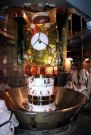 At Launch Pad 17-A, Cape Canaveral Air Station, the Stardust spacecraft is revealed after removal of a protective canister. Stardust is targeted for launch on Feb. 6 aboard a Boeing Delta II rocket. The spacecraft is destined for a close encounter with the comet Wild 2 in January 2004. Using a silicon-based substance called aerogel, Stardust will capture comet particles flying off the nucleus of the comet. The spacecraft also will bring back samples of interstellar dust. These materials consist of ancient pre-solar interstellar grains and other remnants left over from the formation of the solar system. Scientists expect their analysis to provide important insights into the evolution of the sun and planets and possibly into the origin of life itself. The collected samples will return to Earth in a sample return capsule to be jettisoned as Stardust swings by Earth in January 2006