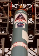 The first stage of a Boeing Delta II rocket is guided to its vertical position on the tower at Launch Complex 17, Cape Canaveral Air Station. The rocket will carry the Stardust spacecraft into space for a close encounter with the comet Wild 2 in January 2004. Using a medium called aerogel, it will capture comet particles flying off the nucleus of the comet, plus collect interstellar dust for later analysis. The collected samples will return to Earth in a Sample Return Capsule to be jettisoned as Stardust swings by Earth in January 2006. Stardust is scheduled to be launched on Feb. 6, 1999