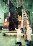 Loral workers at Astrotech, Titusville, Fla., check out the solar panels of the GOES-L [ http://www-pao.ksc.nasa.gov/kscpao/captions/subjects/goes-l.htm ] weather satellite, to be launched from Cape Canaveral Air Station (CCAS) aboard an Atlas II rocket in late March. The GOES-L is the fourth of a new advanced series of geostationary weather satellites for the National Oceanic and Atmospheric Administration. It is a three-axis inertially stabilized spacecraft that will provide pictures and perform atmospheric sounding at the same time. Once launched, the satellite, to be designated GOES-11, will undergo checkout and provide backup capabilities for the existing, aging GOES East weather satellite