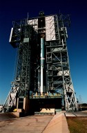 At Pad 17A, Cape Canaveral Air Station, a Boeing Delta II rocket waits with its four solid rocket boosters for final preparations to launch the Stardust satellite on Feb. 6, 1999. The rocket will carry Stardust into space for a close encounter with the comet Wild 2 in January 2004. Using a medium called aerogel, Stardust will capture comet particles flying off the nucleus of the comet, plus collect interstellar dust for later analysis. The collected samples will return to Earth in a Sample Return Capsule to be jettisoned as Stardust swings by Earth in January 2006