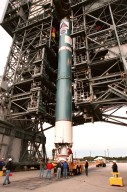 Workers at Cape Canaveral Air Station help guide the first stage of a Boeing Delta II rocket to its vertical position on the tower at Launch Complex 17. The rocket will carry the Stardust spacecraft into space for a close encounter with the comet Wild 2 in January 2004. Using a medium called aerogel, it will capture comet particles flying off the nucleus of the comet, plus collect interstellar dust for later analysis. The collected samples will return to Earth in a Sample Return Capsule to be jettisoned as Stardust swings by Earth in January 2006. Stardust is scheduled to be launched on Feb. 6, 1999