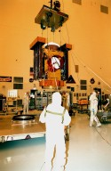 In the Payload Hazardous Servicing Facility, workers raise the Stardust [ http://www-pao.ksc.nasa.gov/kscpao/captions/subjects/stardust.htm ] spacecraft from its workstand to move it to another area for lighting tests on the solar panels. Stardust is scheduled to be launched aboard a Boeing Delta II rocket from Launch Pad 17A, Cape Canaveral Air Station, on Feb. 6, 1999, for a rendezvous with the comet Wild 2 in January 2004. Stardust will use a substance called aerogel to capture comet particles flying off the nucleus of the comet, plus collect interstellar dust for later analysis. The collected samples will return to Earth in a sample return capsule to be jettisoned as it swings by Earth in January 2006