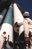 At Pad 17A, Cape Canaveral Air Station, workers keep watch on the placement of the fourth and final solid rocket booster (SRB) being mated with the Boeing Delta II rocket. The rocket will be aided by four SRBs to carry the Stardust satellite into space for a close encounter with the comet Wild 2 in January 2004. Using a medium called aerogel, Stardust will capture comet particles flying off the nucleus of the comet, plus collect interstellar dust for later analysis. The collected samples will return to Earth in a Sample Return Capsule to be jettisoned as Stardust swings by Earth in January 2006. Stardust is scheduled to be launched on Feb. 6, 1999