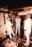 """In the Space Station Processing Facility, Marsha Ivins (left), a mission specialist on the STS-98 crew, discusses the U.S. Laboratory with members of the laboratory's processing team, (left to right) James Thews, Suzanne Fase, and Danny Whittington. The laboratory module, considered the centerpiece of the International Space Station (ISS), has been named """"Destiny"""" in honor of its prominent role in the world?s largest science and technology effort. It is planned for launch aboard Space Shuttle Endeavour on the sixth ISS construction flight currently targeted for March 2000"""