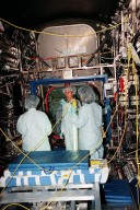 """In the Space Station Processing Facility, Marsha Ivins (center), a mission specialist on the STS-98 crew, talks with Suzanne Fase, (left) and Melissa Orozco (right), members of the U.S. Laboratory's processing team. The laboratory module, considered the centerpiece of the International Space Station (ISS), has been named """"Destiny"""" in honor of its prominent role in the world?s largest science and technology effort. It is planned for launch aboard Space Shuttle Endeavour on the sixth ISS construction flight, currently targeted for March 2000."""