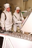 STS-93 Mission Specialists Catherine Coleman (left) and Michel Tognini of France (right), who represents the Centre National d'Etudes Spatiales (CNES), look over the controls for the Chandra X-ray Observatory. Chandra is being mated with the Inertial Upper Stage (IUS) before testing to validate the IUS/Chandra connections and to check the orbiter avionics interfaces. Following that, an end-to-end test (ETE) will be conducted to verify the communications path to Chandra, commanding it as if it were in space. With the world's most powerful X-ray telescope, Chandra will allow scientists from around the world to see previously invisible black holes and high-temperature gas clouds, giving the observatory the potential to rewrite the books on the structure and evolution of our universe. Chandra is scheduled for launch July 22 aboard Space Shuttle Columbia, on mission STS-93