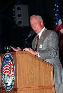 """KENNEDY SPACE CENTER, FLA. -- Former Apollo 15 astronaut Alfred M. Worden relates his experiences in the Apollo Program during a banquet honoring the people who made it all possible. Held on the anniversary of the Apollo 11 mission, which was launched July 16, 1969, and landed on the moon July 20, 1969, the banquet was held in the Apollo/Saturn V Center. Worden served as command module pilot on the Apollo 15 mission. Other guests at the banquet were astronauts Neil Armstrong, Wally Schirra, Edwin """"Buzz"""" Aldrin and Walt Cunningham. Armstrong was the first man to walk on the moon; Gene Cernan was the last"""