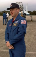 STS-89 Mission Specialist Andrew Thomas, Ph.D., poses for photographers at Kennedy Space Center's Shuttle Landing Facility after arriving to prepare for launch later this week. Thomas will replace David Wolf, M.D., on the Russian Space Station Mir. Launch is scheduled for January 22 at 9:48 p.m. EST