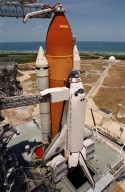 "KENNEDY SPACE CENTER, Fla. -- After rollback of the Rotating Service Structure, Space Shuttle Atlantis is poised and ready on Launch Pad 39A for a fourth launch attempt on mission STS-101. At the top of the photo can be seen the Gaseous Oxygen Vent Hood, often called the ""beanie cap."" The hood helps vent gaseous oxygen vapors away from the Space Shuttle. The hood will be raised and retracted two and a half minutes before launch. Abutting the side of Atlantis is the orbiter access arm with the environmental chamber known as the White Room at the end. The White Room provides access to the crew compartment. In the background of the photo is the Atlantic Ocean. This will be the third assembly flight to the International Space Station. Liftoff of Space Shuttle Atlantis for the 10-day mission is scheduled for about 6:12 a.m. EDT from Launch Pad 39A. Landing is targeted for May 29 at 2:19 a.m. EDT. This is the 98th Shuttle flight and the 21st flight for Shuttle Atlantis"