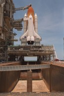 "KENNEDY SPACE CENTER, Fla. -- After rollback of the Rotating Service Structure, Space Shuttle Atlantis can be seen atop the mobile launcher platform (MLP) on Launch Pad 39A. Below the MLP is the flame trench, part of the flame deflector system that insulates pad structures from the intense heat of launch. Made of concrete and refractory brick, the trench is 490 feet long, 48 feet wide and 40 feet high. At the top of the orange external tank can be seen the Gaseous Oxygen Vent Hood, often called the ""beanie cap."" The hood helps vent gaseous oxygen vapors away from the Space Shuttle. The hood will be raised and retracted two and a half minutes before launch. Abutting the side of Atlantis is the orbiter access arm with the environmental chamber known as the White Room at the end. The White Room provides access to the crew compartment. This will be the third assembly flight to the International Space Station. Liftoff of Space Shuttle Atlantis for the 10-day mission is scheduled for about 6:12 a.m. EDT from Launch Pad 39A. Landing is targeted for May 29 at 2:19 a.m. EDT. This is the 98th Shuttle flight and the 21st flight for Shuttle Atlantis"