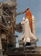 "KENNEDY SPACE CENTER, Fla. -- After rollback of the Rotating Service Structure at Launch Pad 39A, Space Shuttle Atlantis awaits a fourth launch attempt on mission STS-101. At the top of the orange external tank can be seen the Gaseous Oxygen Vent Hood, often called the ""beanie cap."" The hood helps vent gaseous oxygen vapors away from the Space Shuttle. The hood will be raised and retracted two and a half minutes before launch. Abutting the side of Atlantis is the orbiter access arm with the environmental chamber known as the White Room at the end. The White Room provides access to the crew compartment. This will be the third assembly flight to the International Space Station. Liftoff of Space Shuttle Atlantis for the 10-day mission is scheduled for about 6:12 a.m. EDT from Launch Pad 39A. Landing is targeted for May 29 at 2:19 a.m. EDT. This is the 98th Shuttle flight and the 21st flight for Shuttle Atlantis"