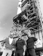 KENNEDY SPACE CENTER, FLA. -- U.S. astronauts Thomas Stafford (left), Vance Brand (center) and Donald Slayton pose in front of their Apollo Soyuz Test Project space vehicle during rollout ceremonies at KSC. The 224-foot-tall Saturn IB launch vehicle began its five-mile journey from the Vehicle Assembly Building to Complex 39's Pad at 8 a.m. The ASTP launch is scheduled for 3:50 p.m. EDT on July 15. During the mission the U.S. Apollo spacecraft will rendezvous and dock with the Soviet Soyuz spacecraft. It will be history's first international manned space flight.