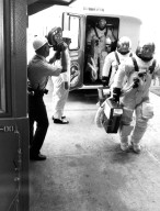 KENNEDY SPACE CENTER, FLA. -- ASTP asstronauts Donald slayton, Vance Brand and Thomas Stafford leave the transfer van at Complex 39's Pad B and enter the pad elevator during the Countdown Demonstration Test. The test, a step-by-step dress rehearsal for the July 15 launch, simulates the actual countdown but without the propellants in the Saturn IB launch vehicle's fuel tanks. The fueled portion of the test was conducted yesterday.