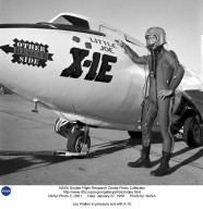 """Joe Walker in a pressure suit beside the X-1E at the NASA High-Speed Flight Station, Edwards,California. The dice and """"Little Joe"""" are prominently displayed under the cockpit area. (Little Joe is a dice players slang term for two deuces.) Walker is shown in the photo wearing an early Air Force partial pressure suit. This protected the pilot if cockpit pressure was lost above 50,000 feet. Similar suits were used in such aircraft as B-47s, B-52s, F-104s, U-2s, and the X-2 and D-558-II research aircraft. Five years later, Walker reached 354,200 feet in the X-15. Similar artwork - reading """"Little Joe the II"""" - was applied for the record flight. These cases are two of the few times that research aircraft carried such nose art."""