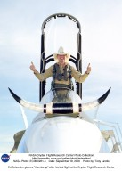 """In a lighter mood, Ed Schneider gives a """"thumbs-up"""" after his last flight at the Dryden Flight Research Center on September 19, 2001. Schneider arrived at the NASA Ames-Dryden Flight Research Facility on July 5, 1982, as a Navy Liaison Officer, becoming a NASA research pilot one year later. He has been project pilot for the F-18 High Angle-of-Attack program (HARV), the F-15 aeronautical research aircraft, the NASA B-52 launch aircraft, and the SR-71 """"Blackbird"""" aircraft. He also participated in such programs as the F-8 Digital Fly-By-Wire, the FAA/NASA 720 Controlled Impact Demonstration, the F-14 Automatic Rudder Interconnect and Laminar Flow, and the F-104 Aeronautical Research and Microgravity projects."""