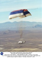 The X-38 prototype of the Crew Return Vehicle for the International Space Station is suspended under its giant 7,500-square-foot parafoil during its eighth free flight on Thursday, Dec. 13, 2001. A portion of the descent was flown by remote control by a NASA astronaut from a ground vehicle configured like the CRV's interior before the X-38 made an autonomous landing on Rogers Dry Lake.