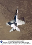 The modified F/A-18 being flown in the joint NASA/Air Force Active Aeroelastic Wing research program shows off its colors during its first checkout flight from NASA's Dryden Flight Research Center.