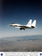 NASA Dryden's F-15B testbed aircraft flew several flights recently in support of an experiment to determine the precise location of sonic shockwave development as air passes over an airfoil. The shock location sensor developed by TAO Systems, Hampton, Virginia, utilizes a multi-element hot-film sensor array along with a constant-voltage anemometer and special diagnostic software to pinpoint the exact location of the shock wave and its characteristics as it passes over an aircraft surface. For this experiment, the 45-element sensor was mounted on a Dryden-designed airfoil which was attached to the right side of the underbelly Flight Test Fixture on the F-15B. Tests were flown at transonic speeds of Mach 0.7 to 0.9, and the device isolated the location of the shock wave to within a half-inch. Project officials said that closer spacing of the sensors and underlying pressure orifices would result in even more precise location of shockwave development.