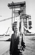 Dr. von Braun In Front of a Display of Missiles