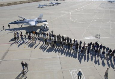 Dryden staff formed long lines on the ramp to greet retired research pilot Gordon Fullert