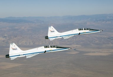 Dryden's two T-38A Mission Support Aircraft Fly in Tight Formation