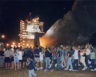 Public views evening engine test of a Space Shuttle Main Engine