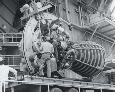 Space Shuttle Main Engine is Hoisted Into Test Stand