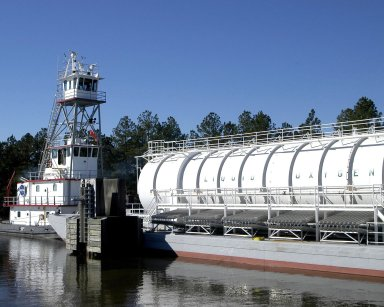 Tug Clermont II moves a LOX-filled barge on the canal