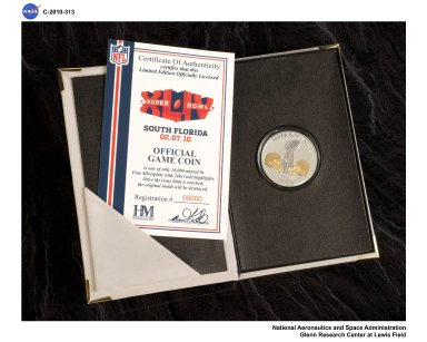 Super Bowl XLIV Game Coin which flew on STS-128