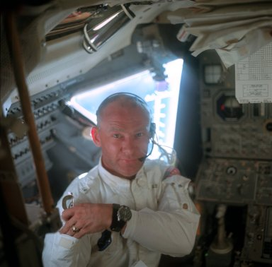Astronaut Edwin E. Aldrin Jr.,Lunar Module pilot,works inside the Lunar Module LM during checkout and inspection after hatch opening. Image taken during the transluner phase of the Apollo 11 Mission by Astronaut Neil A. Armstrong, Commander of the Apollo 11 Mission. Original film magazine was labeled N; Film type: S0-368 Color; 80mm lens.