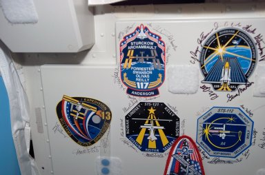 Signed patches on wall in the Node 1 during Joint Operations