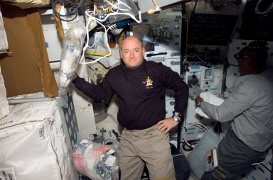 View of Kelly posing for a photo in the MDDK during STS-118