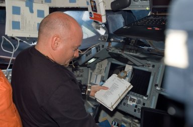 View of Kelly working in the FD during STS-118