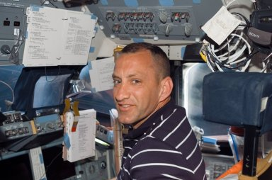 View of Hobaugh posing for a photo in the FD during STS-118