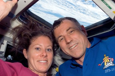 View of Caldwell and Williams posing for a photo in the FD during STS-118