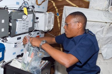 View of Drew working with FDF Accessory Kit in the MDDK during STS-118