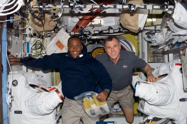View of MS Williams and Drew posing with EMUs in the A/L during STS-118