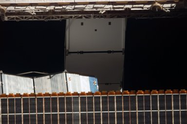 View of the S1 Radiator and P6 Solar Arrays taken from the orbiter after undocking from the ISS during STS-121